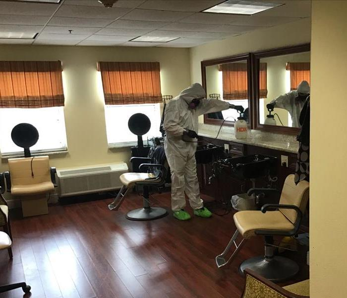 SERVPRO technician cleaning an office