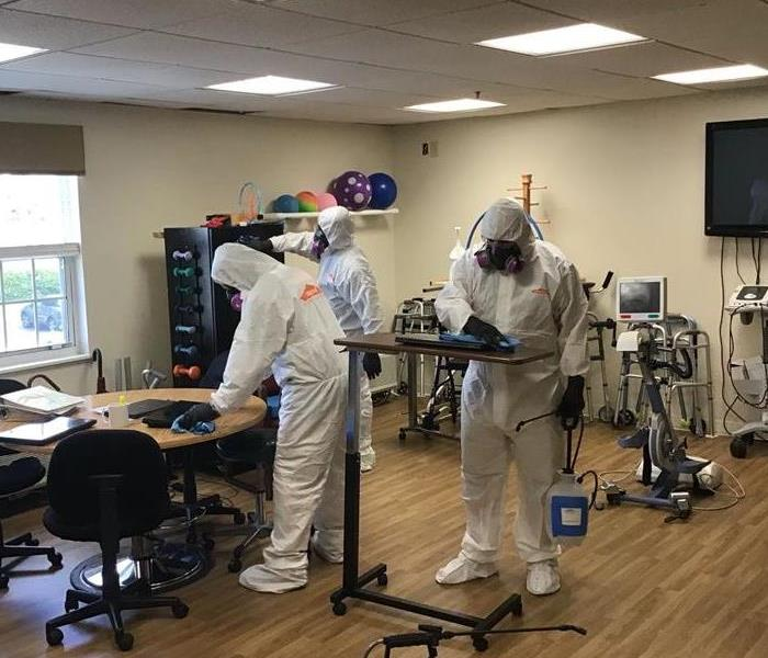 SERVPRO technicians in PPE at a commercial cleaning job