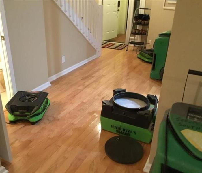 Air movers in foyer of a home