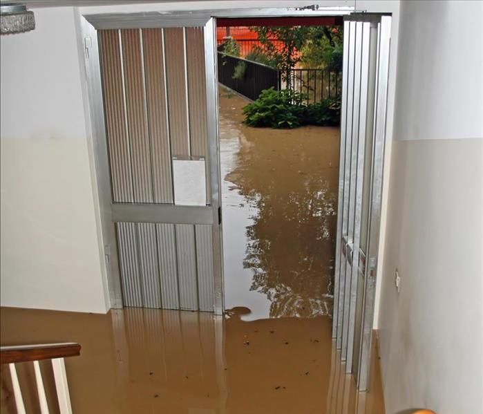 Rain water flooding the entrance of a home