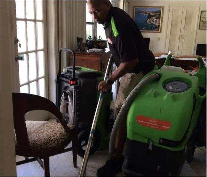Technician cleaning after water loss in a home